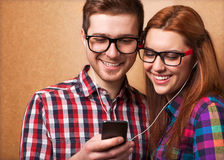 Young couple listening music Stock Image