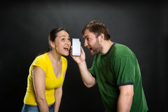 Young couple listening to the joke Stock Image