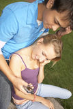 A young couple listening to music. Royalty Free Stock Photography