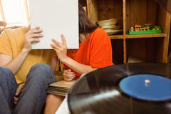 Young couple listening to vinyl record Stock Photo