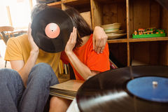 Young couple listening to vinyl record Stock Image