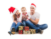 Young couple with little boy and presents on the floor Stock Images