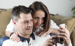 Young couple in living room stock photos