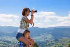 Young couple looking around. Mountain countryside summer view stock image
