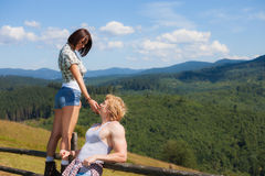 Young couple looking around. Mountain countryside summer view stock images