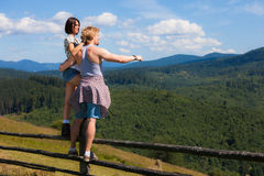 Young couple looking around. Mountain countryside summer view Royalty Free Stock Photo