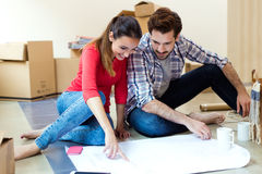 Young couple looking at the blueprints of their new home Stock Photo