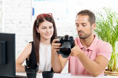 A young couple looking at  camera Stock Photos