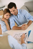 Young couple looking at contruction plan Stock Photos