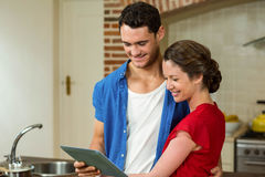 Young couple looking at digital tablet Stock Image