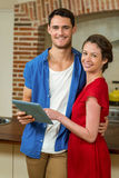 Young couple looking at digital tablet Royalty Free Stock Photos