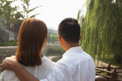 Young Couple Looking Downstream Royalty Free Stock Image