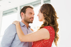 Young couple looking at each other and embracing Royalty Free Stock Photography