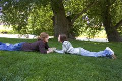 Young couple looking at each other at the Park Royalty Free Stock Photography