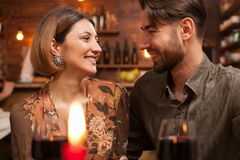 Young couple looking in each others eyes and laughing royalty free stock image