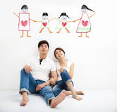 Young Couple looking the family concept draw. Happy Young Couple looking the family concept draw royalty free stock image