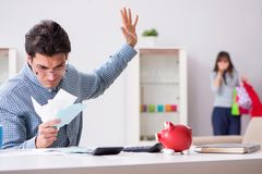 The young couple looking at family finance papers. Young couple looking at family finance papers Stock Photos