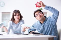 The young couple looking at family finance papers. Young couple looking at family finance papers Stock Images
