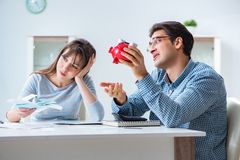 The young couple looking at family finance papers. Young couple looking at family finance papers Royalty Free Stock Images