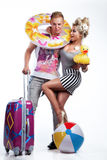 Young couple looking forward to the holidays. Young couple with suitcases looking forward to the holidays Stock Images