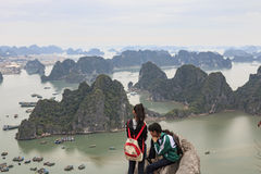 Young couple looking at Halong Bay and city from the top of Bai Tho Mountain Stock Images