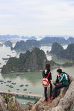 Young couple looking at Halong Bay and city from the top of Bai Tho Mountain Stock Photography