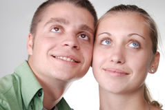 young couple looking happily into the distance Stock Photos