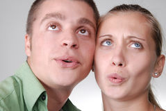 Young couple looking happily into the distance Stock Image