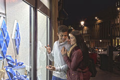 Young couple looking at jewellery Royalty Free Stock Photo