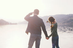 Young couple looking on lake Royalty Free Stock Photo