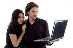 Young couple looking into laptop Stock Photo