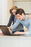 Young couple looking at laptop Royalty Free Stock Images