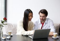 Young couple looking at laptop. Portrait of a young couple looking at laptop Stock Images