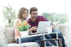 Young couple looking at a laptop screen Stock Photo