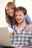Young Couple Looking At Laptop Together. Young Couple Look At Laptop Together Stock Image