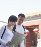 Young couple looking at map. Stock Photos