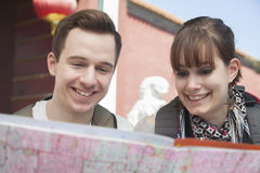 Young couple looking at map. Stock Image