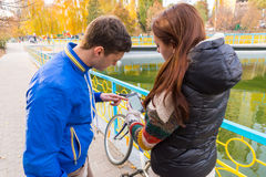 Young Couple Looking at Map App on Cell Phone Stock Photography