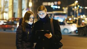 Young couple looking map of the city on the tablet stock video