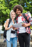 Young couple looking at map Stock Photos