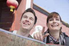 Young couple looking at map and pointing. Stock Photo