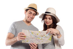 Young couple looking at the map. Royalty Free Stock Image