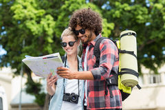 Young couple looking at map Stock Images