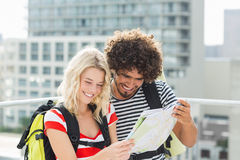 Young couple looking at map Royalty Free Stock Images