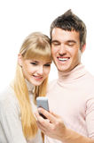 Young couple looking at mobile Royalty Free Stock Photography