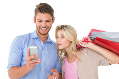 Young couple looking at mobile phone Stock Photography