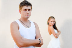 Young couple looking in opposite directions Royalty Free Stock Image
