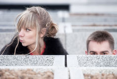 Young couple looking out stock photography
