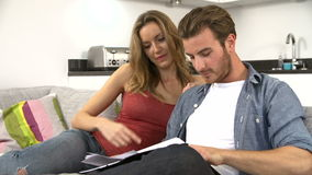 Young Couple Looking Through Personal Finances At Home stock video