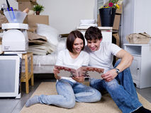 Young couple looking the photo album Stock Image